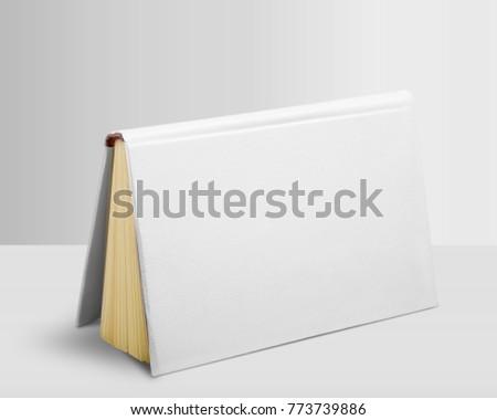 Whte book on white desk Royalty-Free Stock Photo #773739886