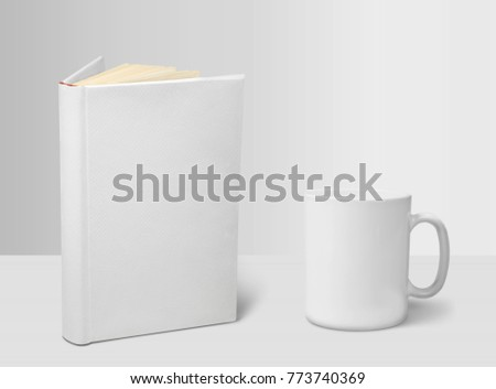 Whte book and cup on white desk Royalty-Free Stock Photo #773740369