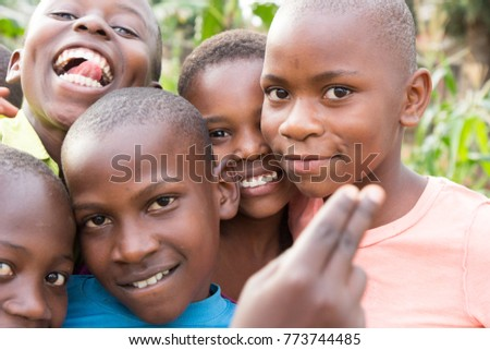 Lugazi, Uganda. June 18 2017. A group of Ugandan children smiling and waving. #773744485