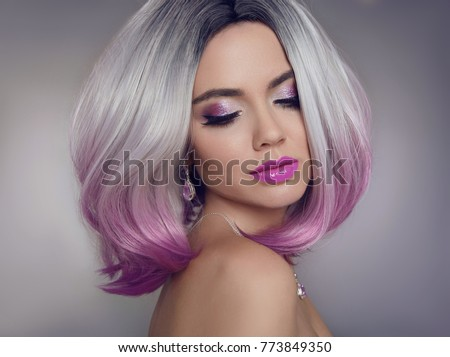 Colored Ombre hair extensions. Beauty Model Girl blonde with short bob purple hairstyle isolated on gray background. Closeup woman portrait. #773849350