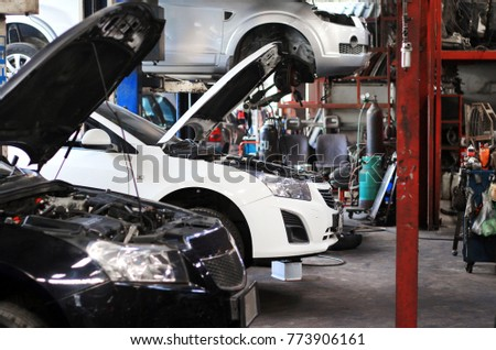 Row of cars under maintenance and repair in service station at car garage. #773906161