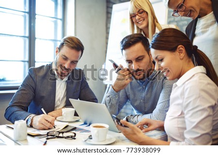 Creative business team working on project. Creative director is showing chart to the workers. #773938099