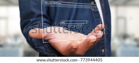 Businessman on blurred background holding and touching a website page sketch