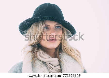 Winter day. Beautiful winter portrait of young woman in the winter snowy scenery. #773971123