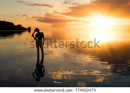 Lovely poster of image of woman on the beach, in Mauritius. #774002473