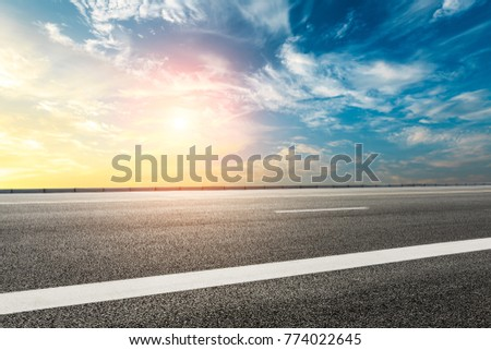 Empty highway asphalt road and beautiful sky sunset landscape #774022645