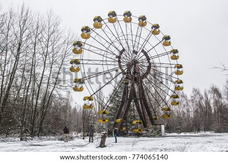 CHERNOBYL, UKRAINE - December 2017: Abandoned ferris wheel in the center of Pripiat town in Chernobyl exclusion zone on cold winter day, Ukraine #774065140