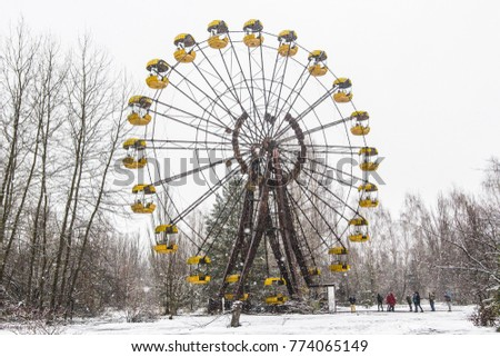 CHERNOBYL, UKRAINE - December 2017: Abandoned ferris wheel in the center of Pripiat town in Chernobyl exclusion zone on cold winter day, Ukraine #774065149