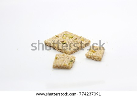 Peanuts in sesame seeds on white background #774237091