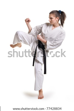 punch.figure in the karate fighting stance on a white background.hand-to-hand fighting #77428834