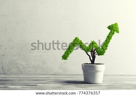 Small plant in pot shaped like growing graph Royalty-Free Stock Photo #774376357