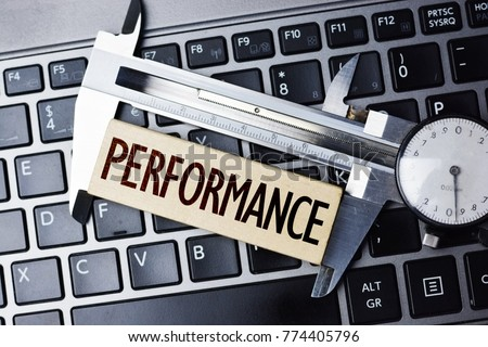 Performance measurement or level with caliper on computer notebook #774405796