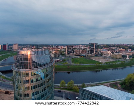 Aerial view over Vilnius business district during cloudy summer sun down, Lithuania. #774422842