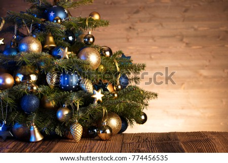 Christmas background. Gifts, blue and gold decorations. #774456535