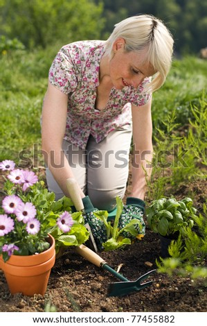 Young woman gardening outdoor close up shoot #77455882