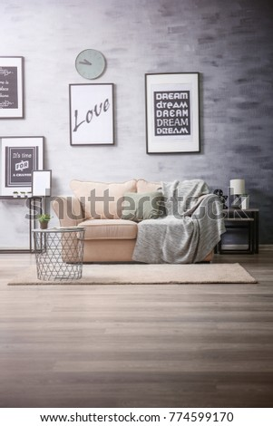 Interior of living room with comfortable sofa #774599170