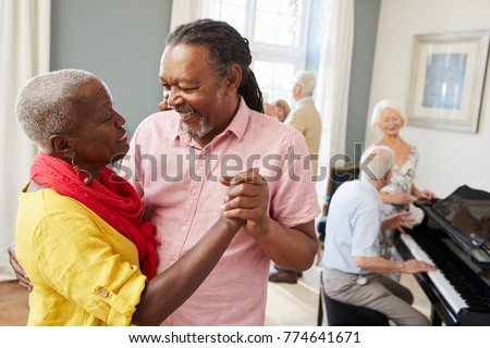 Group Of Seniors Enjoying Dancing Club Together #774641671
