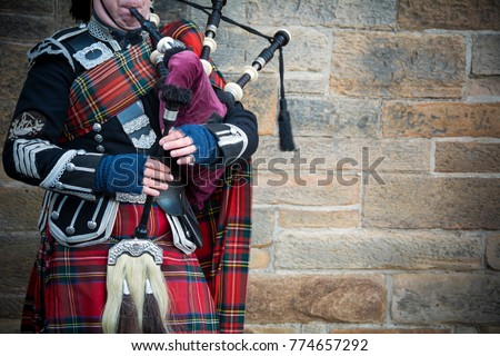 Playing the bagpipes on streets of Edinburgh #774657292