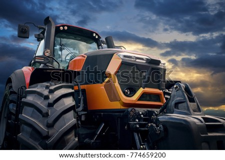 Tractor working on the farm, a modern agricultural transport, a farmer working in the field, tractor at sunset, modern tractor closeup #774659200