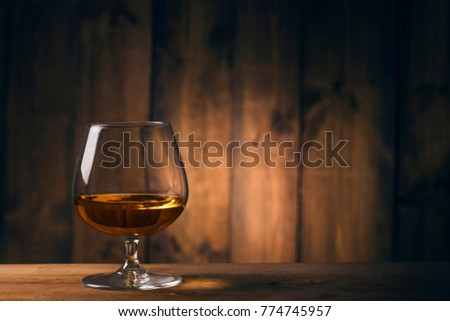 Glass of Cognac  Royalty-Free Stock Photo #774745957