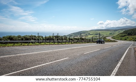 Scottish road trip. A view south along the arterial A9 road north of Helmsdale in the north east of Scotland. The road is one of the most northerly A roads on the British mainland. #774755104