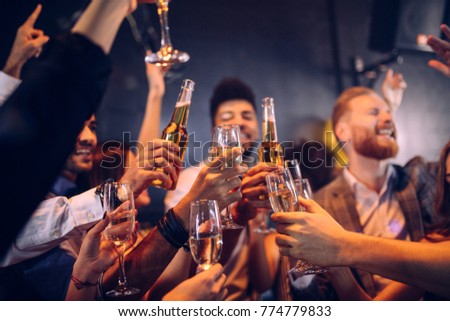 Group of friends cheering with champagne and beer #774779833