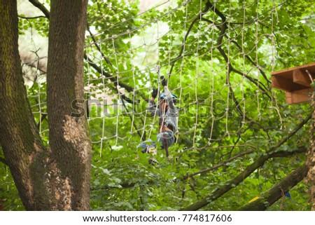 Child in a adventure playground #774817606