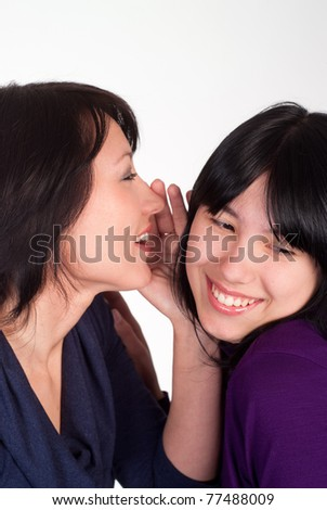 two pretty girls together on a white background #77488009