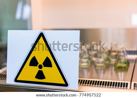 sign of radiation hazard on the background of radioactive samples in the laboratory
