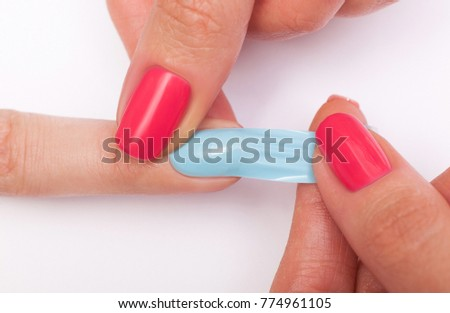 Manicure. Master make nail extension. Finger closeup with false-nails    #774961105