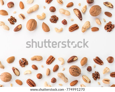 Pattern of nuts mix with copy space. Various nuts isolated on white. Pecan, macadamia, brazil nut, walnut, almonds, hazelnuts, pistachios, cashews, peanuts, pine nuts. Top view or flat-lay. Copy space #774991270