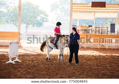Ber Yakov, Israel - September 21, 2016: Horse riding lessons for kids. The boy on the horse #775004845
