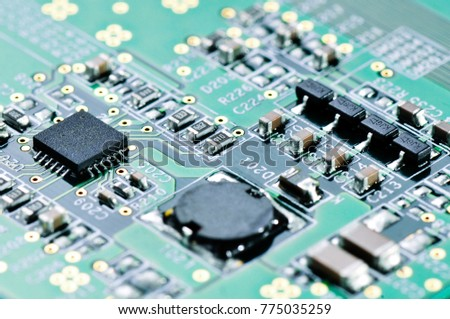 Integrated microchip on green circuit board. #775035259