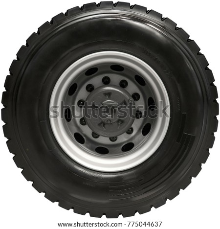 Isolated on white new rear truck wheel on hub with black shine tire. New clean tractor truck wheel tire. Wheel mud tire on rim on rear axle. High resolution truck wheel isolated #775044637