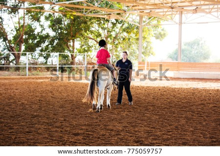 Ber Yakov, Israel - September 21, 2016: Horse riding lessons for kids. The boy on the horse #775059757