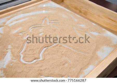 wooden box with glass for drawing with sand and picture of horse