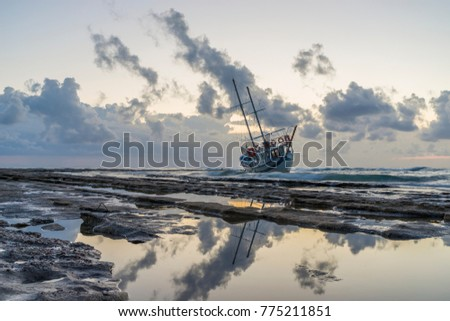 Fishing boat shipwreck or abandoned shipwreck. , Wrecked boat abandoned stand on beach in RHodes Greece #775211851