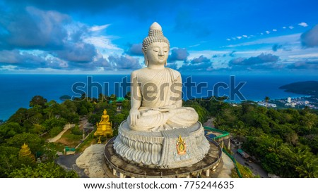 blue sky and blue ocean are on the back of Phuket Big Buddha statue.white Phuket big Buddha is the one of landmarks on Phuket island. #775244635