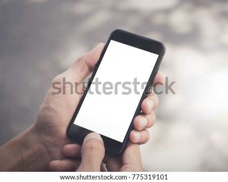 Image of man's hands are holding and touch a black cell phone with white blank screen that can put any idea and concept in this space. #775319101