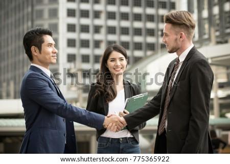 Business people shaking hands, good job, partnership, congratulations, business deal and business teamwork concept. #775365922