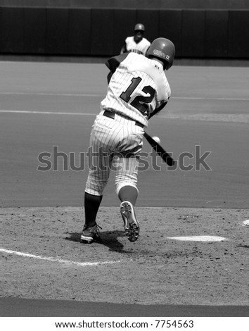 Black and white photo of a batter hitting the ball