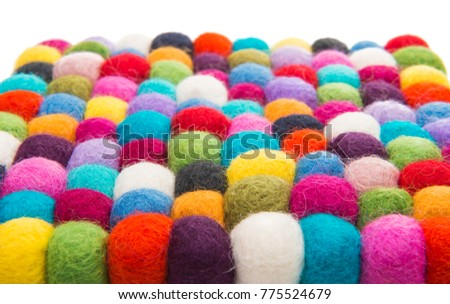 colored felted balls on white background #775524679