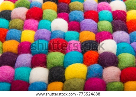 colored felted balls on white background #775524688