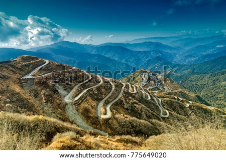Beautiful Curvy roads on Old Silk Route, past Silk trading route between China and India, Sikkim. This is now part of One belt one road project (OBOR) connecting China with Asia and Europe.  Royalty-Free Stock Photo #775649020
