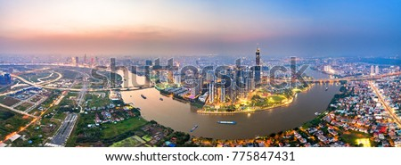 Royalty high quality free stock image aerial view of Ho Chi Minh city, Vietnam. Beauty skyscrapers along river light smooth down urban development in Ho Chi Minh City, Vietnam.  #775847431