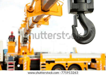 crane operator works in construction site Royalty-Free Stock Photo #775913263
