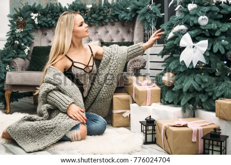 christmas. new year 2018. girl in christmas. girl in lingerie and sweater. a girl in a knitted sweater. girl in a gray sweater #776024704