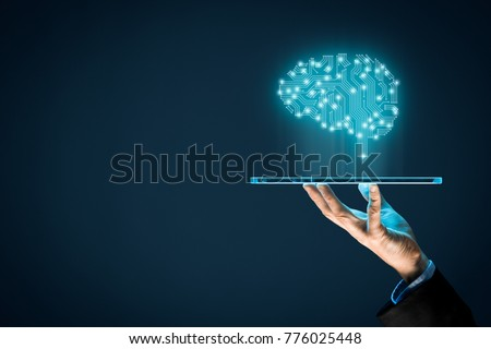Artificial intelligence (AI), machine deep learning, data mining and another modern computer technologies concepts. Brain representing artificial intelligence and businessman holding futuristic tablet #776025448