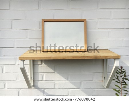 Picture frame on shelf on wall