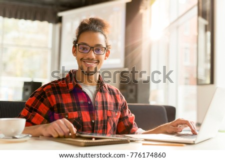 Young manager with laptop searching for online statistics for his business project #776174860